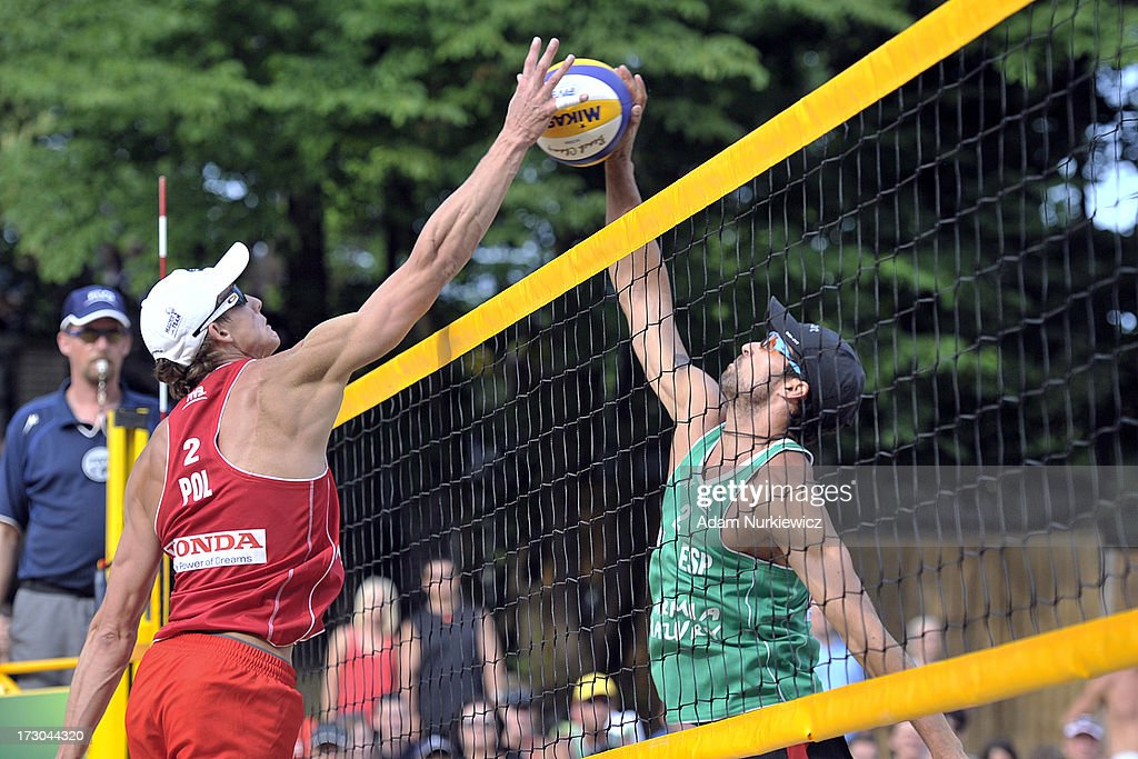Jaroslaw Lech (L) from Poland attacks against Adrian Gavira Collado (R) from Spain during the match between Spain and Poland during Day 5 of the FIVB World Championships on July 5, 2013 in Stare Jablonki, Poland.