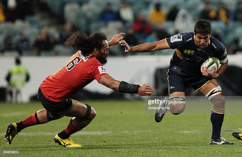 Jarrad Butler of the Brumbies fends off a tackle during the round 14 Super Rugby match between the Brumbies and the Sunwolves at GIO Stadium on May 28, 2016 in Canberra, Australia.