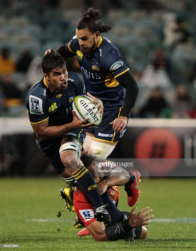 Jarrad Butler of the Brumbies is tackled during the round 14 Super Rugby match between the Brumbies and the Sunwolves at GIO Stadium on May 28, 2016 in Canberra, Australia.