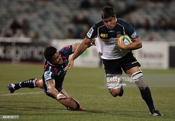 Jarrad Butler of the Brumbies is tackled during the round 16 Super Rugby match between the Brumbies and the Rebels at Canberra Stadium on May 31 2014...