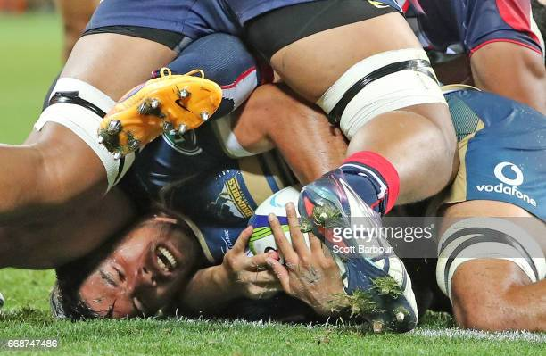 Jarrad Butler of the Brumbies scores a try during the round eight Super Rugby match between the Rebels and the Brumbies at AAMI Park on April 15 2017...