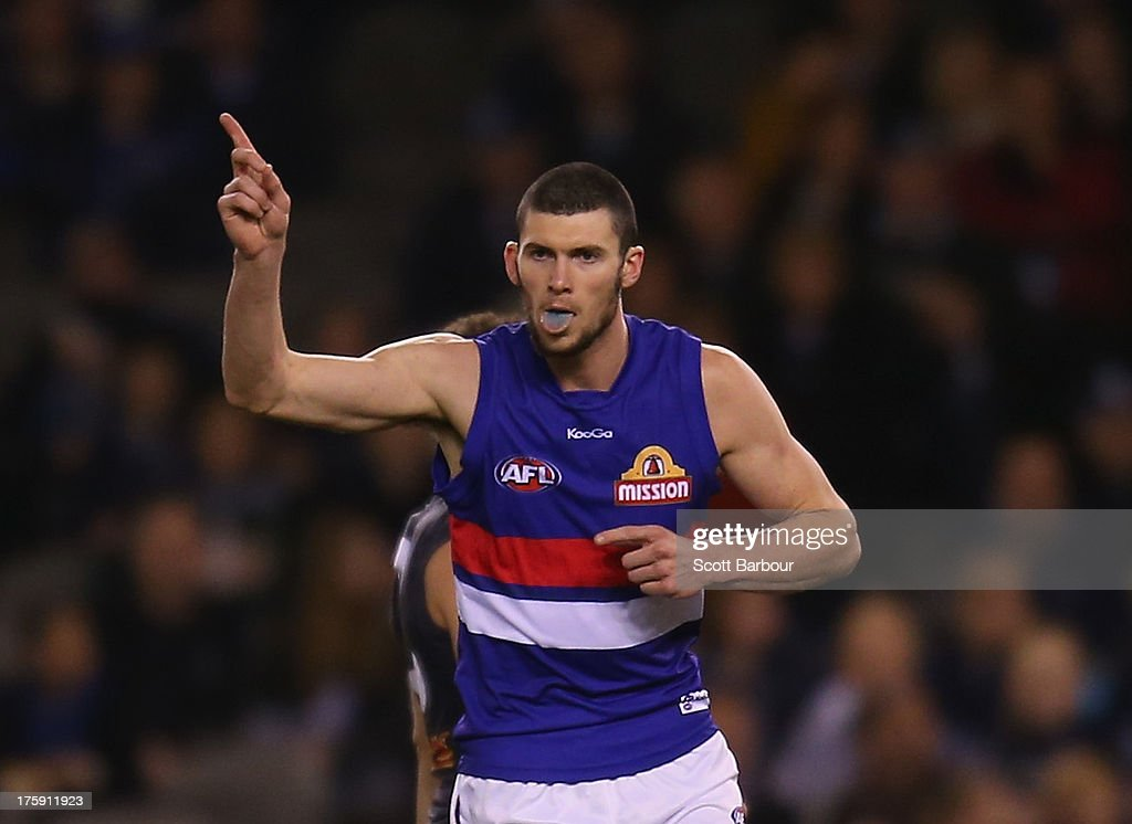 Jarrad Grant of the Bulldogs celebrates after kicking a goal during the round 20 AFL match between the Carlton Blues and the Western Bulldogs at Etihad Stadium on August 10, 2013 in Melbourne, Australia.