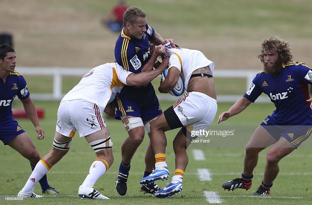 Jarrad Hoeata of the Highlanders tackles Tim Nanai-Williams of the Chiefs during the 2013 Super Rugby pre-season friendly match between the Chiefs and the Highlanders at Owen Delany Park, Taupo on February 2, 2013 in Taupo, New Zealand.