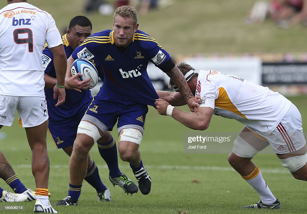 Jarrad Hoeata of the Highlanders tries to break a tackle during the 2013 Super Rugby pre-season friendly match between the Chiefs and the Highlanders at Owen Delany Park, Taupo on February 2, 2013 in Taupo, New Zealand.