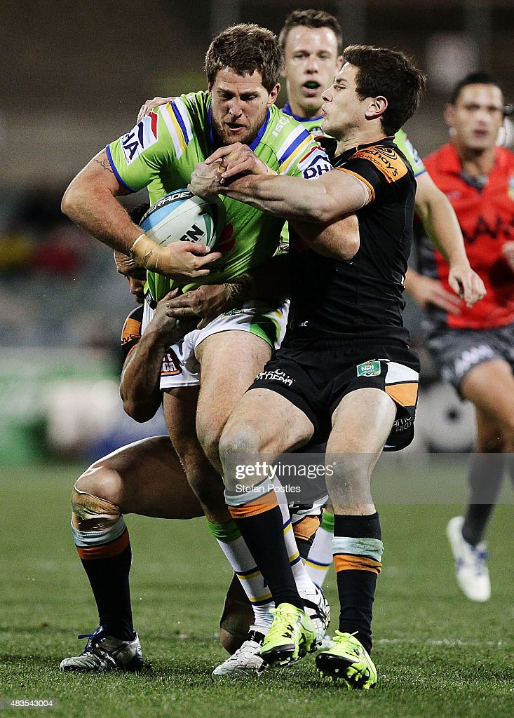 Jarrad Kennedy of the Raiders is tackled during the round 22 NRL match between the Canberra Raiders and the Wests Tigers at GIO Stadium on August 10, 2015 in Canberra, Australia.