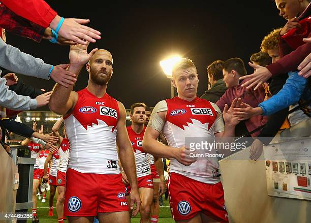 Jarrad McVeigh and Daniel Hannebery of the Swans high five fans after winning the round eight AFL match between the Hawthorn Hawks and the Sydney...
