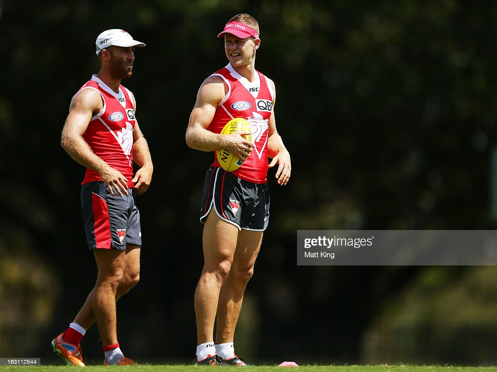 Jarrad McVeigh (L) looks on with Ryan O'Keefe (R) stretches during a Sydney Swans AFL training session at Lakeside Oval on March 5, 2013 in Sydney, Australia.