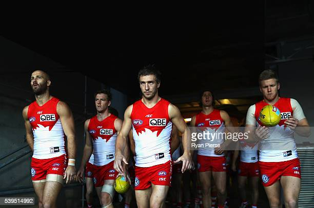 Jarrad McVeigh of and Kieren Jack of the Swans lead their team out during the round 12 AFL match between the Greater Western Sydney Giants and the...