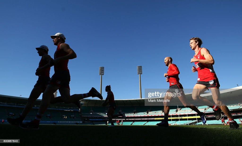 Jarrad McVeigh of the Swans and Callum Mills of the Swans run during a Sydney Swans AFL training session at Sydney Cricket Ground on June 26, 2017 in Sydney, Australia.