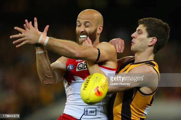 Jarrad McVeigh of the Swans and Luke Breust of the Hawks contest for a mark during the AFL First Qualifying Final match between the Hawthorn Hawks...