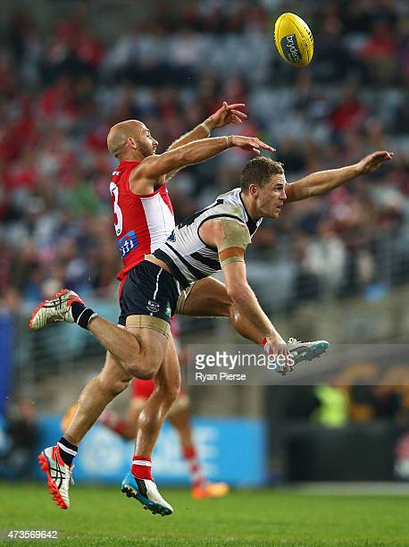 Jarrad McVeigh of the Swans competes for the ball against Joel Selwood of the Cats during the round seven AFL match between the Sydney Swans and the...