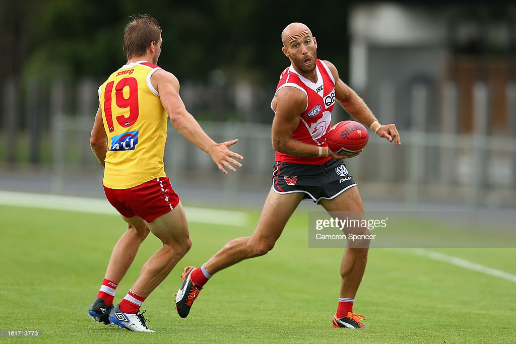Jarrad McVeigh of the Swans hand-passes during an intra-club practice match during a Sydney Swans AFL training session at Moore Park on February 15, 2013 in Sydney, Australia.
