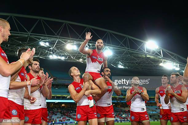 Jarrad McVeigh of the Swans is chaired from the ground after his 250th AFL match the round seven AFL match between the Sydney Swans and the Geelong...