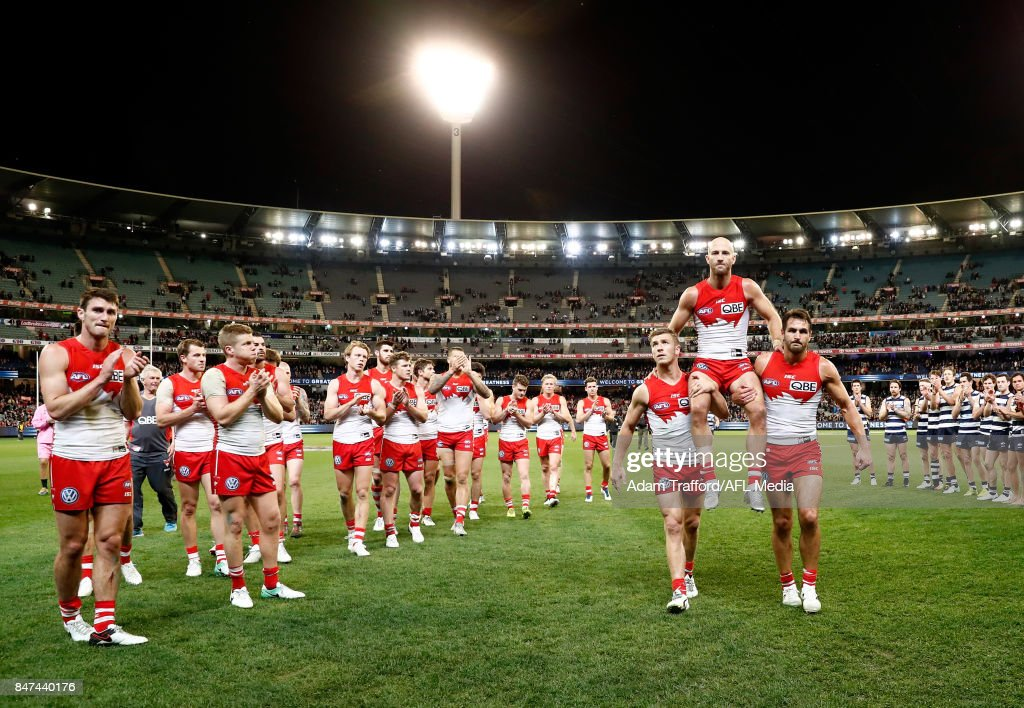 Jarrad McVeigh of the Swans is chaired off after his 300th game by Kieren Jack (left) and Josh Kennedy of the Swans during the 2017 AFL Second Semi Final match between the Geelong Cats and the Sydney Swans at the Melbourne Cricket Ground on September 15, 2017 in Melbourne, Australia.