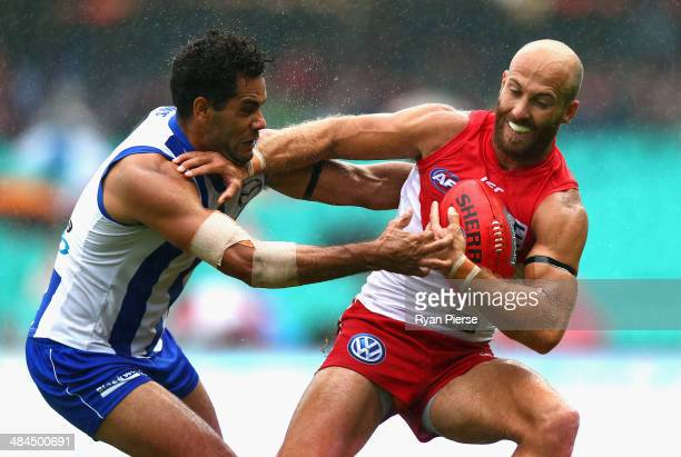 Jarrad McVeigh of the Swans is tackled by Daniel Wells of the Kangaroos during the round four AFL match between the Sydney Swans and the North...