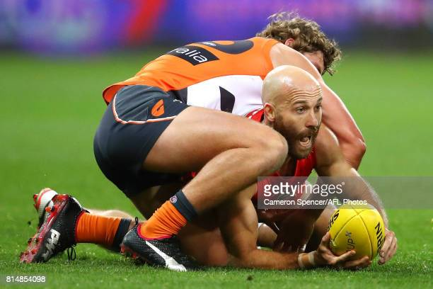 Jarrad McVeigh of the Swans is tackled during the round 17 AFL match between the Greater Western Sydney Giants and the Sydney Swans at Spotless...