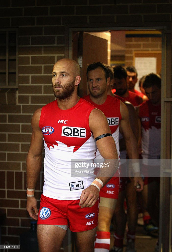 <a gi-track='captionPersonalityLinkClicked' href=/galleries/search?phrase=Jarrad+McVeigh&family=editorial&specificpeople=3083250 ng-click='$event.stopPropagation()'>Jarrad McVeigh</a> of the Swans leads his team out before the round two NAB Cup AFL match between the Sydney Swans and the North Melbourne Kangaroos at Bruce Purser Oval on March 3, 2012 in Sydney, Australia.