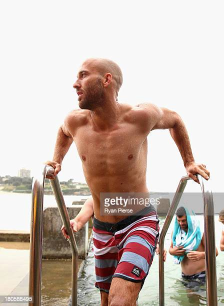 Jarrad McVeigh of the Swans swims during a recovery session at Coogee Beach on September 15 2013 in Sydney Australia