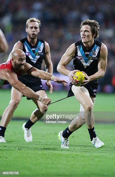 Jarrad McVeigh of the Swans tackles Jared Polec of the Power during the round two AFL match between the Port Adelaide Power and the Sydney Swans at...