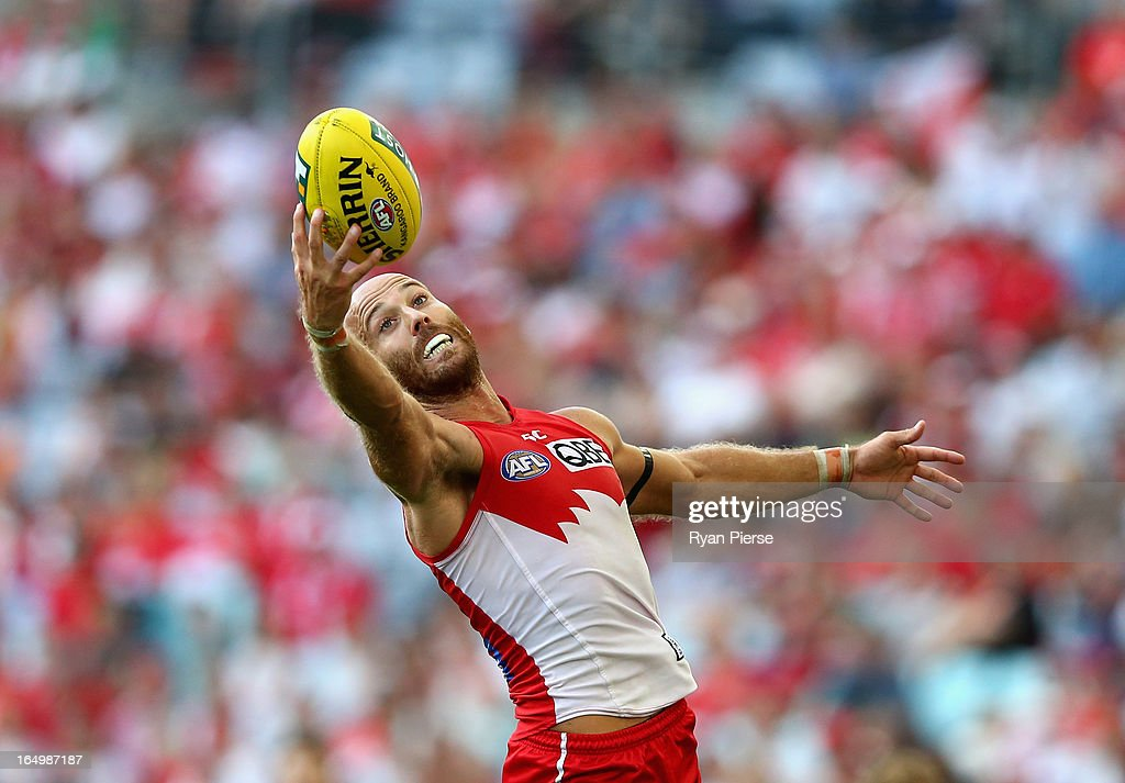 Jarrad McVeigh of the Swans takes a one handed mark during the round one AFL match between the Greater Western Sydney Giants and the Sydney Swans at ANZ Stadium on March 30, 2013 in Sydney, Australia.