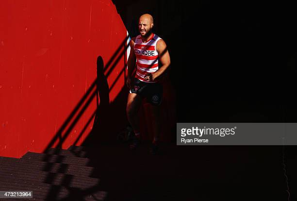 Jarrad McVeigh of the Swans walks onto the field during a Sydney Swans AFL training session at Sydney Cricket Ground on May 14 2015 in Sydney...
