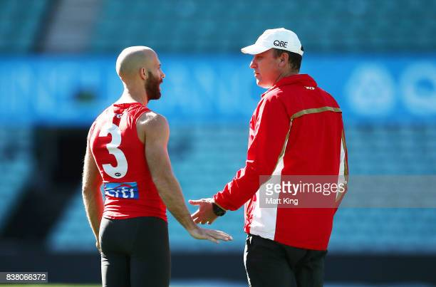 Jarrad McVeigh talks to Swans head coach John Longmire during a Sydney Swans AFL training session at Sydney Cricket Ground on August 24 2017 in...