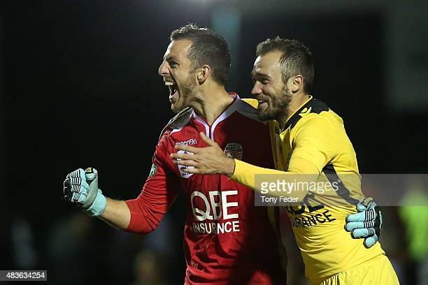 Jarrad Tyson and Gyorgy Sandor of Perth Glory celebrate winning in a penalty shoot outduring the FFA Cup match between Newcastle Jets and Perth Glory...