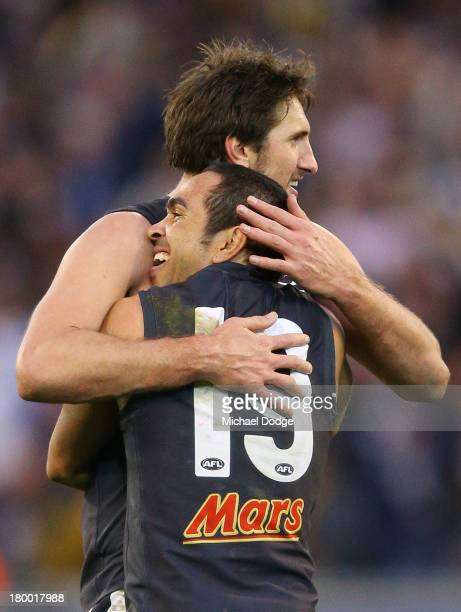 Jarrad Waite and Eddie Betts of the Blues celebrate their win after the final siren during the First Elimination Final AFL match between the Richmond...