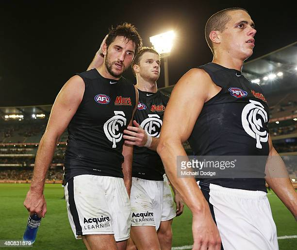 Jarrad Waite is consoled by Lachie Henderson of the Blues after their defeat during the round two AFL match between the Richmond Tigers and the...
