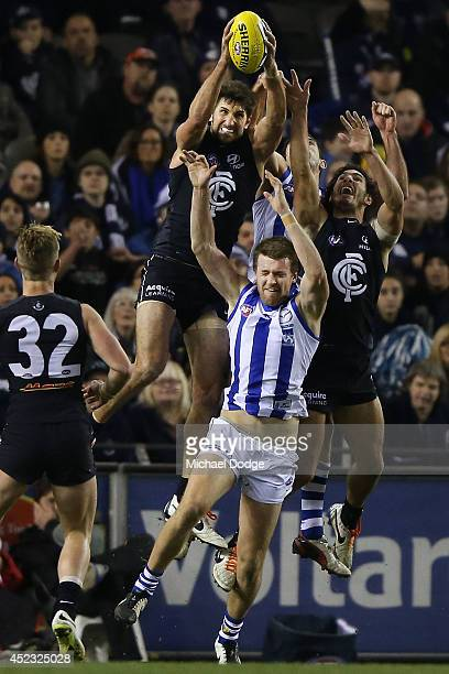 Jarrad Waite of the Blues marks the ball against Lachlan Hansen of the Kangaroos during the round 18 AFL match between the Carlton Blues and the...