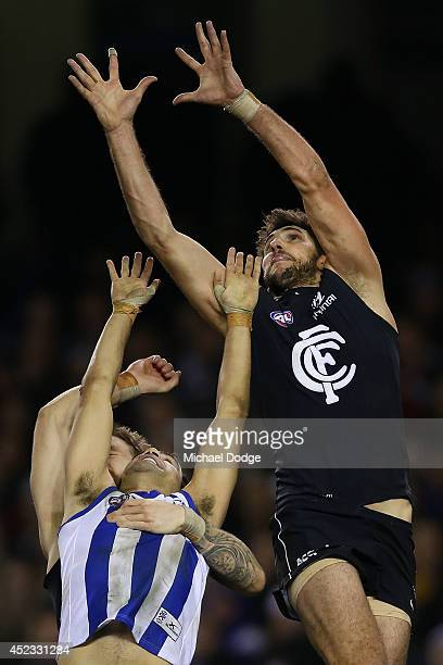 Jarrad Waite of the Blues marks the ball over Lindsay Thomas of the Kangaroos during the round 18 AFL match between the Carlton Blues and the North...