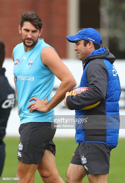 Jarrad Waite of the Kangaroos and Brad Scott coach of the Kangaroos talk during a North Melbourne Kangaroos AFL training session at Arden Street...