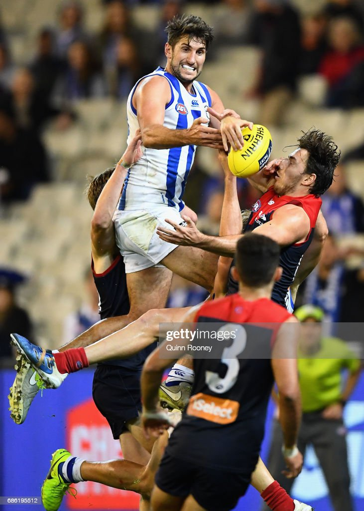 Jarrad Waite of the Kangaroos and Michael Hibberd of the Demons compete for a mark during the round nine AFL match between the Melbourne Demons and the North Melbourne Kangaroos at Melbourne Cricket Ground on May 21, 2017 in Melbourne, Australia.