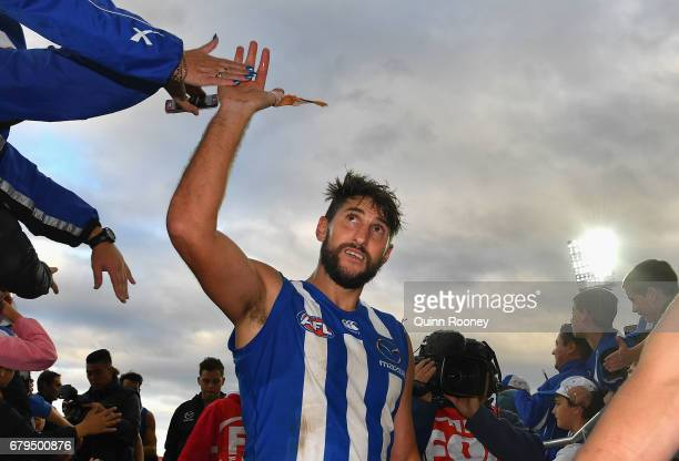 Jarrad Waite of the Kangaroos high fives fans after winning the round seven AFL match between the North Melbourne Kangaroos and the Adelaide Crows at...