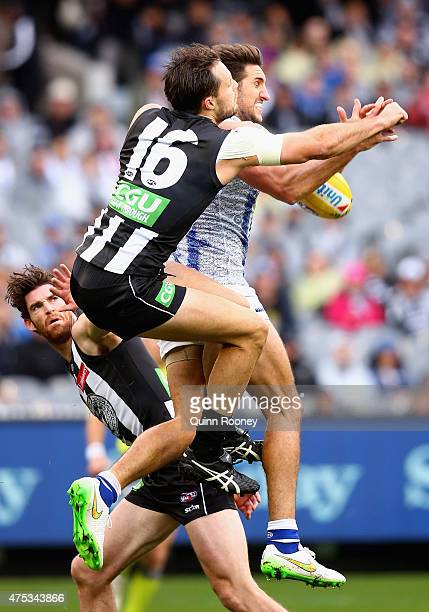 Jarrad Waite of the Kangaroos marks infront of Nathan Brown of the Magpies during the round nine AFL match between the Collingwood Magpies and the...
