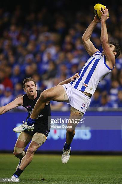 Jarrad Waite of the Kangaroos marks the ball against Sam Docherty of the Blues during the round 18 AFL match between the Carlton Blues and the North...