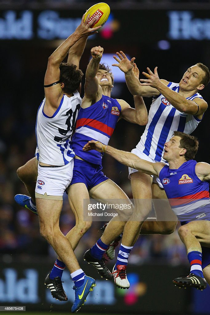 Jarrad Waite of the Kangaroos (L) marks the ball during the round 22 AFL match between the North Melbourne Kangaroos and the Western Bulldogs at Etihad Stadium on August 29, 2015 in Melbourne, Australia.
