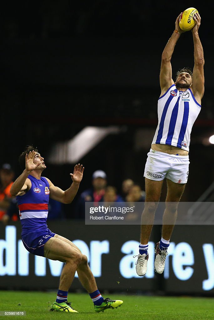 <a gi-track='captionPersonalityLinkClicked' href=/galleries/search?phrase=Jarrad+Waite&family=editorial&specificpeople=224526 ng-click='$event.stopPropagation()'>Jarrad Waite</a> of the Kangaroos marks the ball during the round six AFL match between the North Melbourne Kangaroos and the Western Bulldogs at Etihad Stadium on April 29, 2016 in Melbourne, Australia.