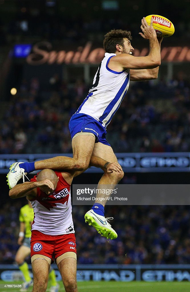Jarrad Waite of the Kangaroos marks the ball over Rhyce Shaw of the Swans during the round 11 AFL match between the North Melbourne Kangaroos and the Sydney Swans at Etihad Stadium on June 13, 2015 in Melbourne, Australia.