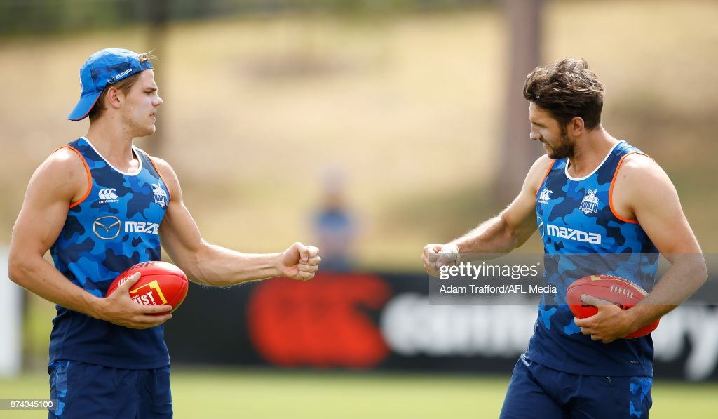 Jarrad Waite of the Kangaroos (right) plays rock, paper, scissors with Mason Wood of the Kangaroos during the North Melbourne Kangaroos training session at Arden St on November 15, 2017 in Melbourne, Australia.