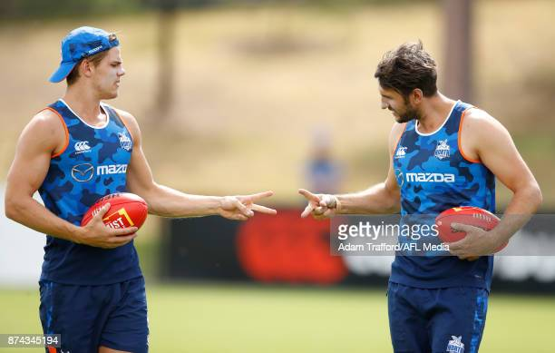 Jarrad Waite of the Kangaroos plays rock paper scissors with Mason Wood of the Kangaroos during the North Melbourne Kangaroos training session at...