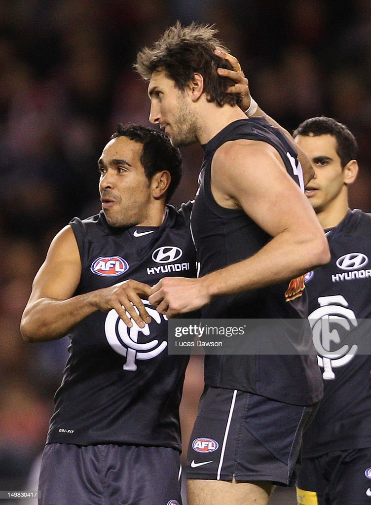 Jarrad Waites and Eddie Betts of the Blues celebrate a goal during the round 19 AFL match between the Carlton Blues and the Sydney Swans at Etihad Stadium on August 5, 2012 in Melbourne, Australia.