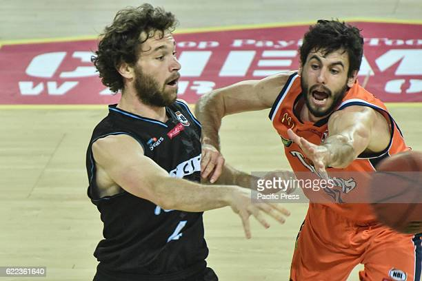 Jarrad Weeks of Taipans completes the ball against Isaih Tueta of breakers during the round six NBL match between the New Zealand Breakers and the...