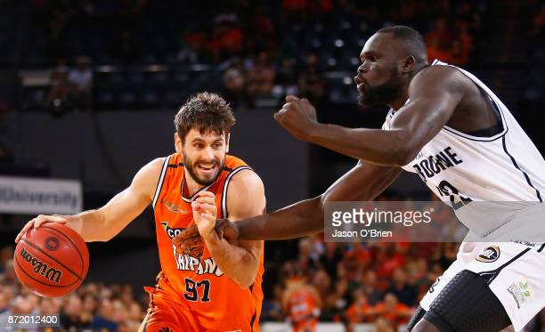 Jarrad Weeks of the Taipans attempts to get around Casper Ware during the round six NBL match between the Cairns Taipans and Melbourne United at...