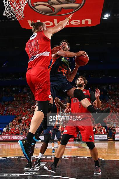 Jarrad Weeks of the Taipans drives to the basket against Jesse Wagstaff of the Wildcats during the round 16 NBL match between the Perth Wildcats and...