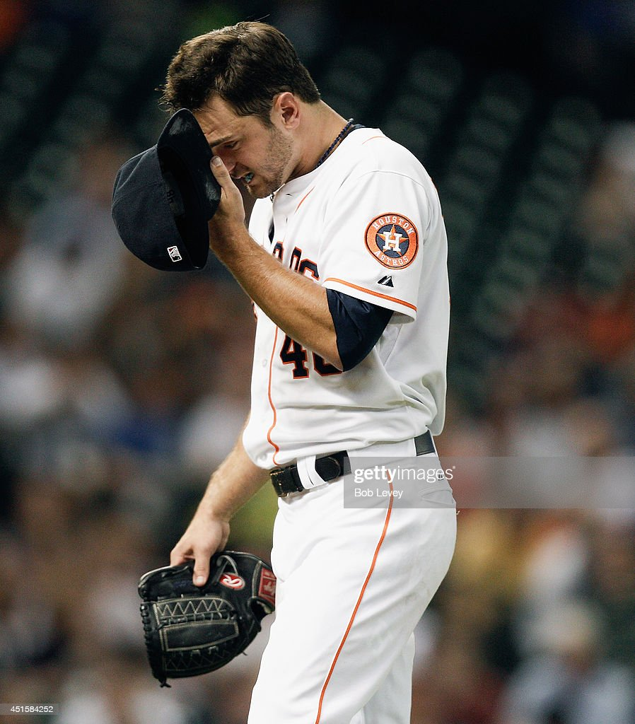 Jarred Cosart #48 of the Houston Astros leaves the game in the sixth inning against the Seattle Mariners at Minute Maid Park on July 1, 2014 in Houston, Texas.