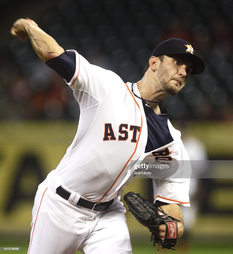 Jarred Cosart #48 of the Houston Astros throws in the first inning against the Seattle Mariners at Minute Maid Park on July 1, 2014 in Houston, Texas.
