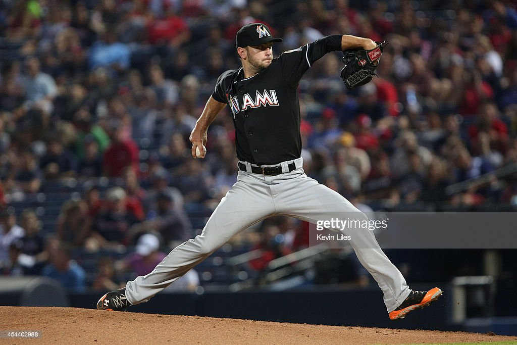 <a gi-track='captionPersonalityLinkClicked' href=/galleries/search?phrase=Jarred+Cosart&family=editorial&specificpeople=7890512 ng-click='$event.stopPropagation()'>Jarred Cosart</a> #23 of the Miami Marlins pitches against the Atlanta Braves during the fourth inning at Turner Field on August 30, 2014 in Atlanta, Georgia.