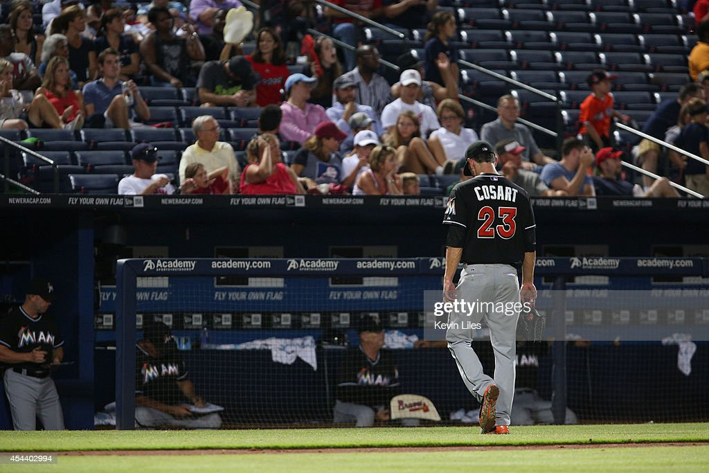 <a gi-track='captionPersonalityLinkClicked' href=/galleries/search?phrase=Jarred+Cosart&family=editorial&specificpeople=7890512 ng-click='$event.stopPropagation()'>Jarred Cosart</a> #23 of the Miami Marlins walks to the dugout after he was pulled from the game against the Atlanta Braves during the eighth inning at Turner Field on August 30, 2014 in Atlanta, Georgia.