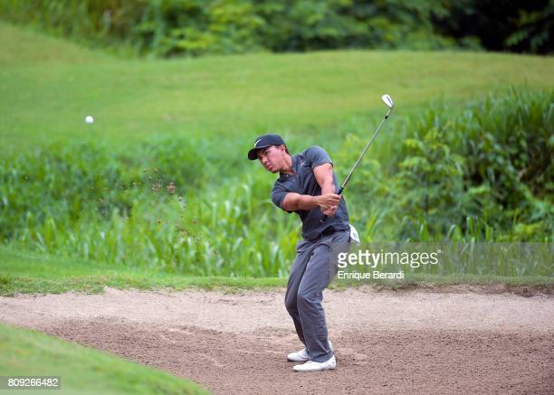 Jarred Garcia of the US chips out of a bunker on the 17th hole during the third round of the PGA TOUR Latinoamerica BMW Jamaica Classic at Cinnamon...